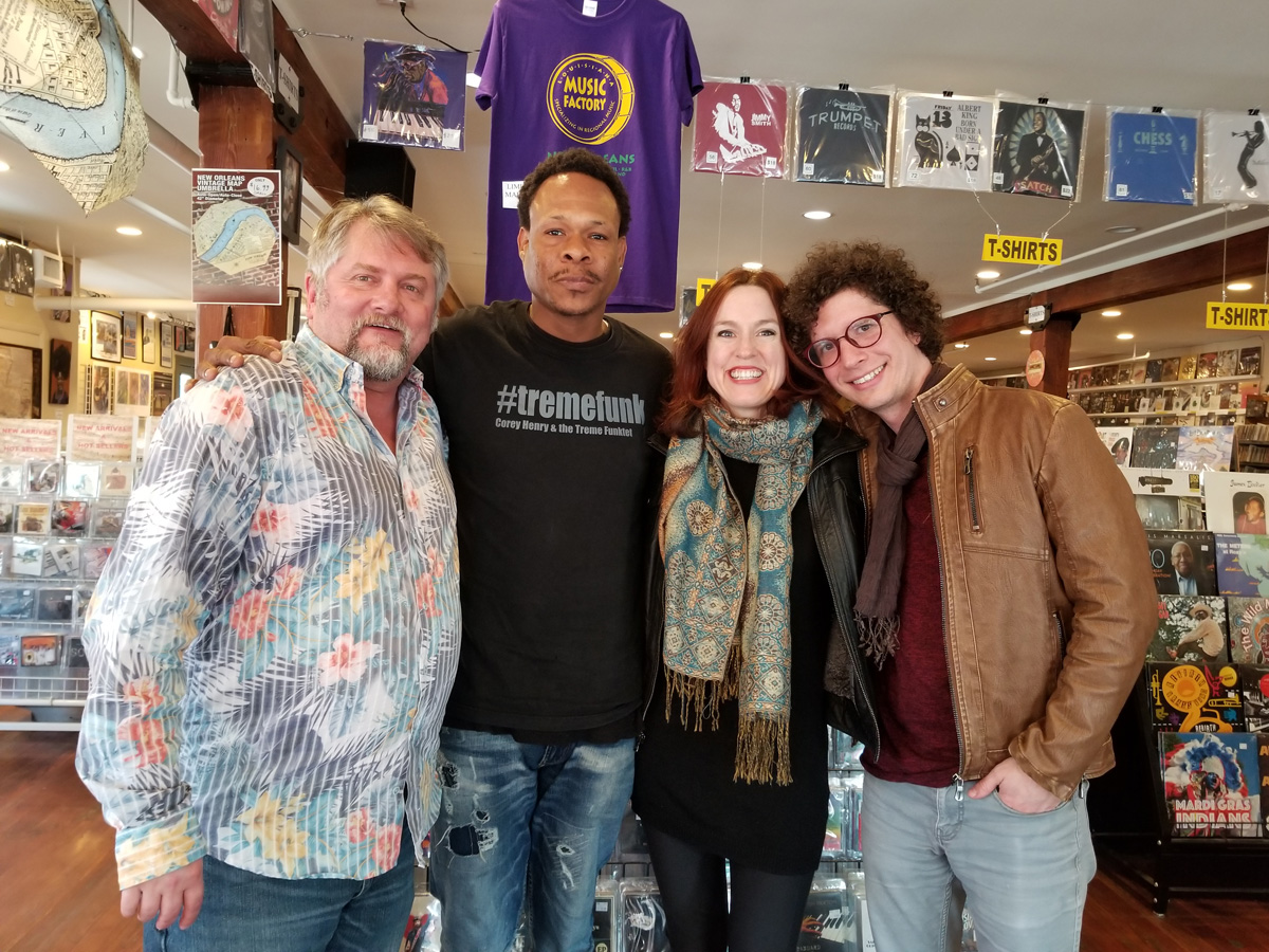 NOLADrinks Show - 2-18-19 - French Quarter Fest Series - Corey Henry and Sweet Crude. Pictured from left - Bryan Dias of The NOLADrinks Show, Corey Henry, Rebecca Sell of French Quarter Festivals, Inc., and Sam Craft of Sweet Crude.
