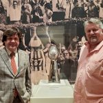 NOLADrinks Show – 12-16-19 – Crescent City Sport – Stories of Courage and Change – Mark Cave of the Historic New Orleans Collection and Bryan Dias of The NOLADrinks Show with the Saints' Lombardi Trophy from the 2010 Super Bowl victory.